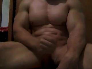 Muskel-Geck das Wichsen tun
